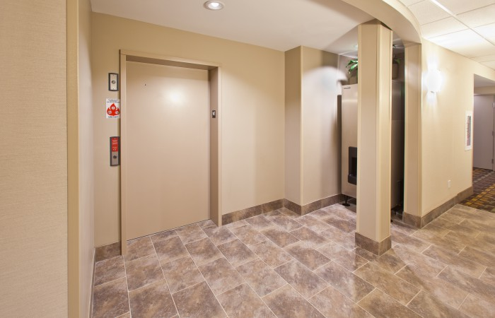 Fairfield - AmericInn - Elevator Corridor - truman howell